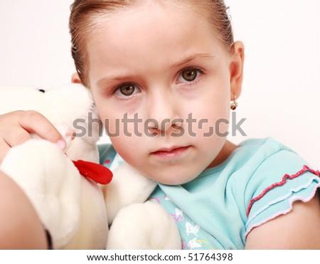 Portrait of sad little girl with teddy - stock photo