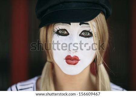 portrait of sad mime with black hat - stock photo