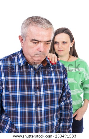 Portrait of sad senior man being comforted by his daughter against white background - stock photo