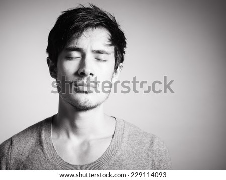 Portrait of sad young men. Sadness - stock photo