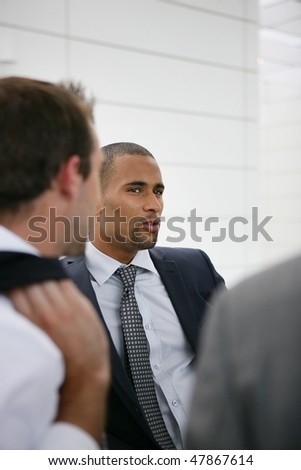 Portrait of salesman in a conference - stock photo