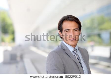 Portrait of salesman in business travel - stock photo