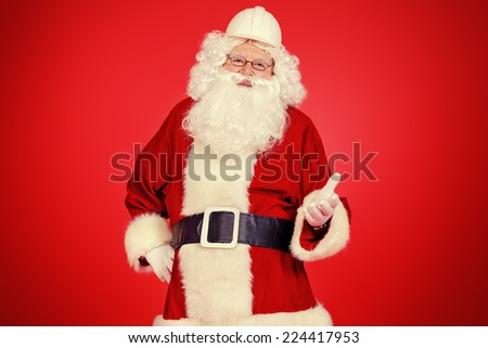 Portrait of Santa Claus - builder in helmet builder. Copy space. - stock photo