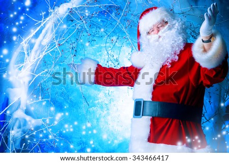 Portrait of Santa Claus in a winter magic forest. Christmas time. - stock photo
