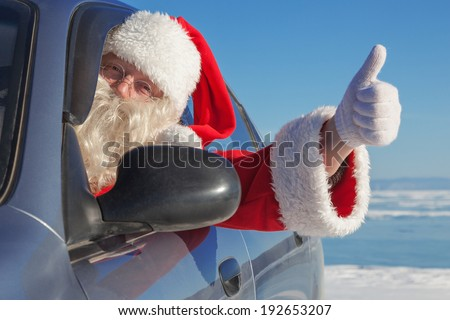 Portrait of Santa Claus in the car, raised thumb gesture - stock photo