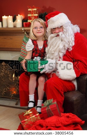 Portrait of Santa Claus with young girl - stock photo