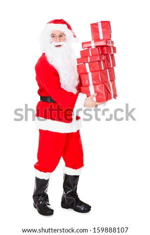 Portrait of santa holding stack of gift on white background - stock photo