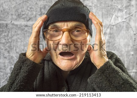 Portrait of scared and worried elderly woman. - stock photo