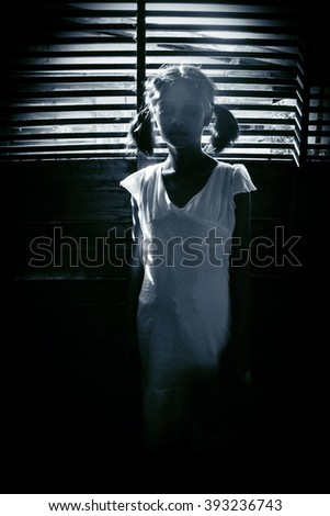 Portrait of scary girl staring at cameras,Ghost girl hiding from the dark,Horror background for halloween  - stock photo