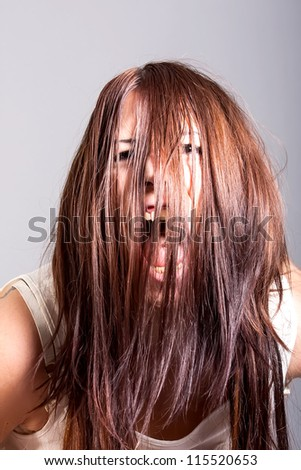 Portrait of scary woman possessed - stock photo