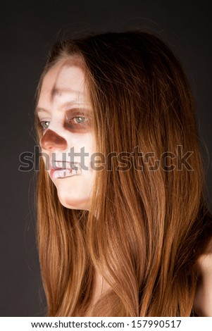 Portrait of scary zombie woman - stock photo