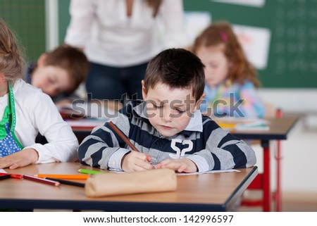 Portrait of schoolchildren being busy in art class at the classroom - stock photo