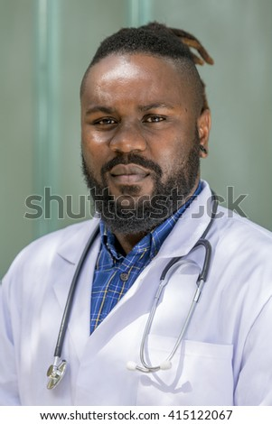 Portrait of self confident black doctor looking at the camera - stock photo
