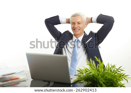 Portrait of senior businessman sit back and relaxing while sitting against white background.  - stock photo