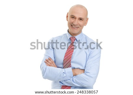 Portrait of senior businessman standing against white background. - stock photo