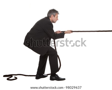 Portrait of senior businessmen pulling a rope. Isolated on white - stock photo