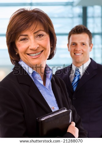 Portrait of senior businesswoman at office lobby. - stock photo
