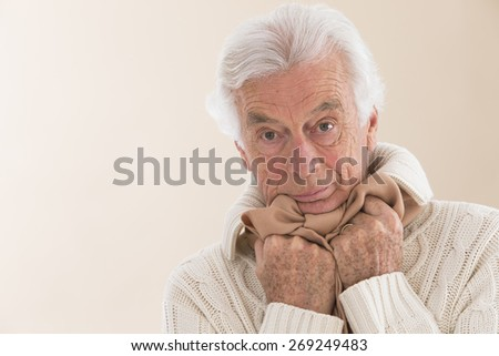Portrait of senior caucasian man with white hair, holding his neck because of throat ache - stock photo