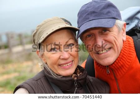 Portrait of senior couple on hiking day - stock photo