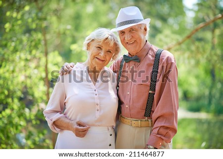 Portrait of senior couple outdoors - stock photo