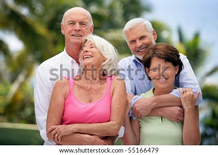 Portrait of senior couples smiling - stock photo