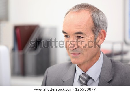 Portrait of senior executive - stock photo