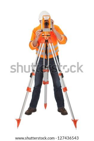 Portrait of Senior land surveyor working with theodelite. Isolated on white - stock photo