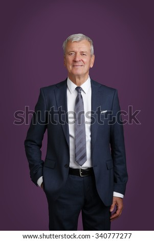 Portrait of senior lawyer standing against isolated background while looking at camera and smiling.   - stock photo