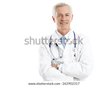 Portrait of senior male doctor standing against white background.  - stock photo