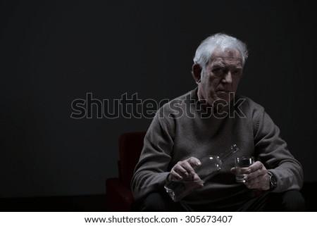 Portrait of senior man addicted to alcohol - stock photo