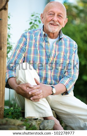 Portrait of senior man outdoors - stock photo