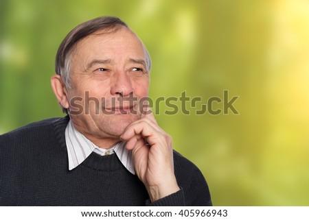 Portrait of senior man outdoors - stock photo
