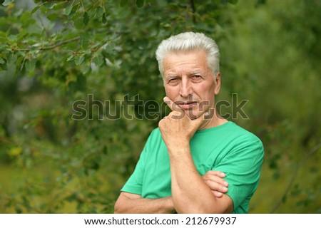 Portrait of senior man thinking about something outddor - stock photo