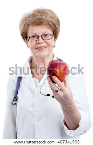 Portrait of senior nutritionist with juicy red apple in hand, isolated on white background - stock photo