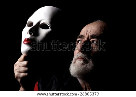 portrait of senior with white mask - stock photo