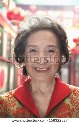 Portrait of senior woman in Chinese traditional clothing - stock photo
