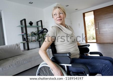 Portrait of senior woman in wheelchair - stock photo