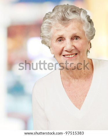 portrait of senior woman smiling indoor - stock photo