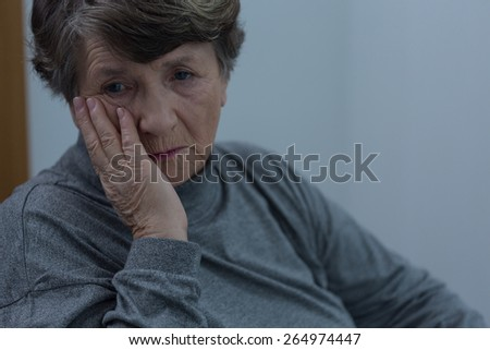 Portrait of senior woman suffering for depression - stock photo