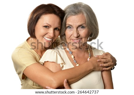 Portrait of Senior woman with daughter on a white background - stock photo