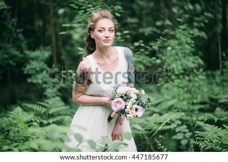 portrait of sensual attractive tattoo bride - stock photo