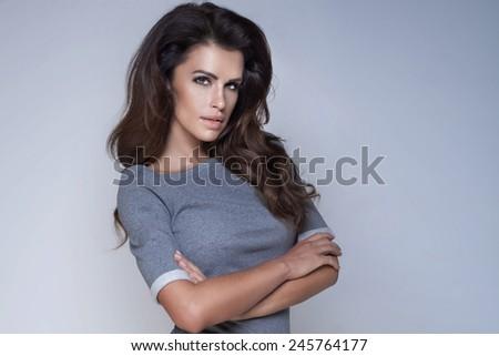 Portrait of sensual beautiful brunette woman in studio. Girl looking at camera.  - stock photo