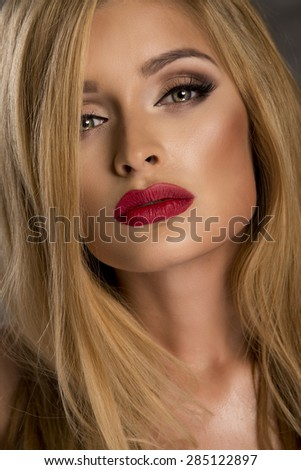 Portrait of sensual blonde delicate woman with red lips - stock photo