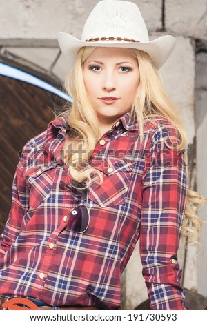 Portrait of Sensual Caucasian Blond Cowgirl on the Farm.Vertical Image - stock photo