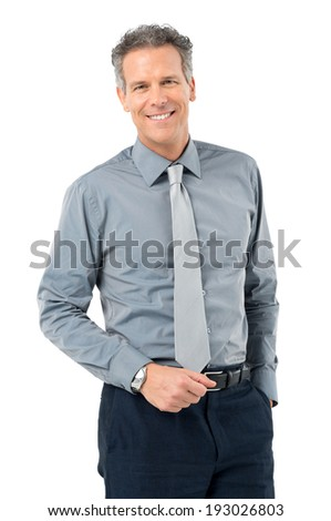 Portrait Of Serene Businessman Looking At Camera Isolated On White Background  - stock photo