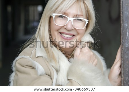 Portrait of serene mature woman-  lovely middle aged woman - stock photo