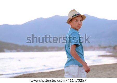 Portrait of serious and pensive young man near sea, outdoor, Italy. - stock photo