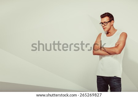Portrait of serious cute man over vintage background - stock photo