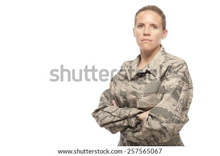 Portrait of serious female airman against white background - stock photo