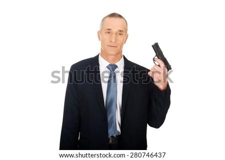 Portrait of serious mafia agent with handgun. - stock photo